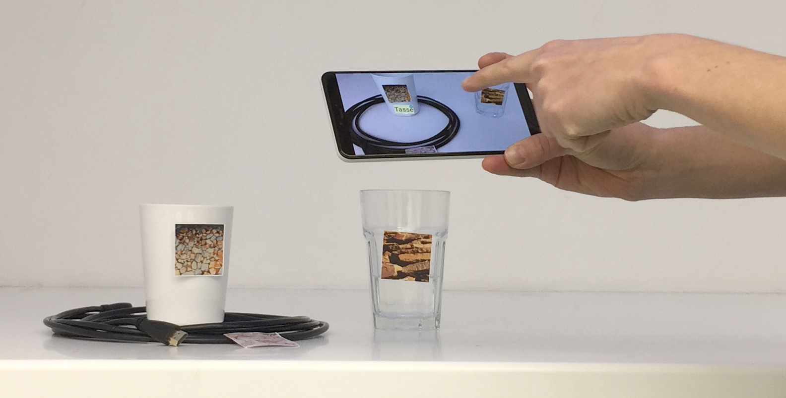 Augmented Reality to Enable Users in Learning Case Grammar from Their Real-World Interactions