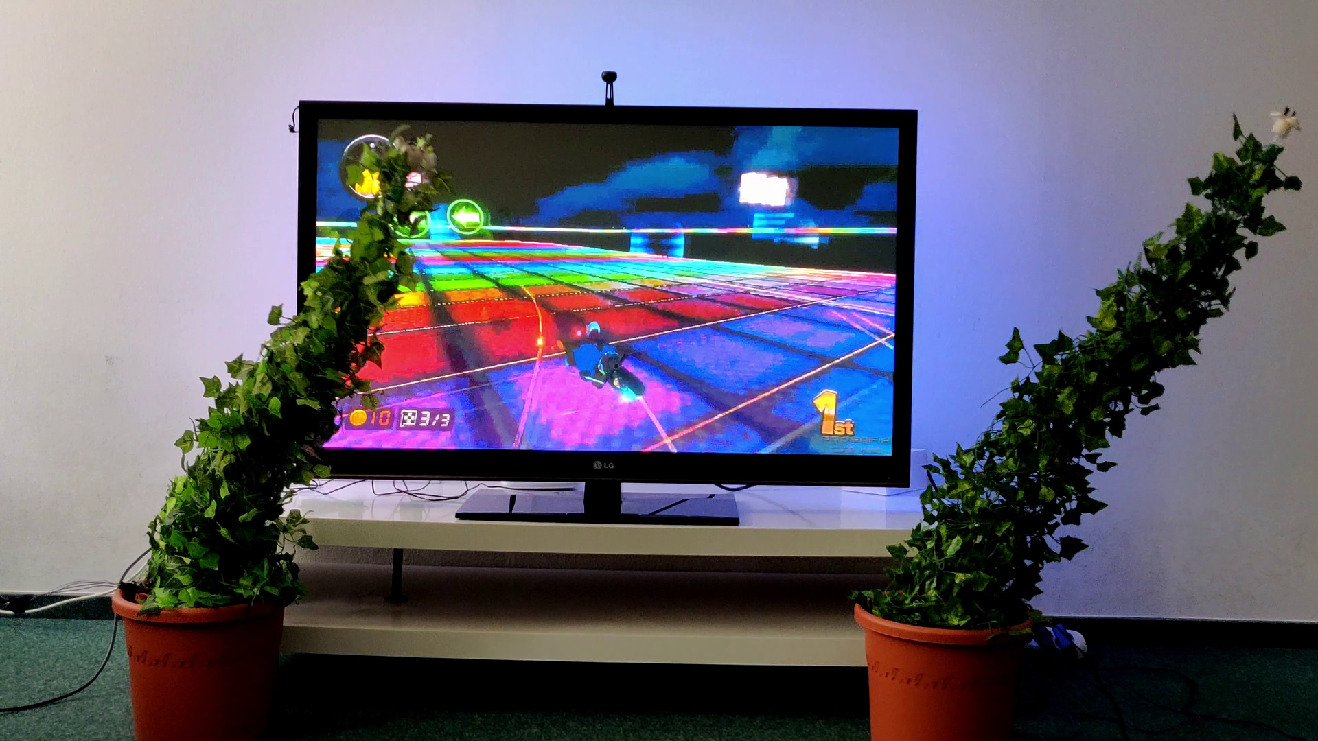 AmbiPlant - Ambient Feedback for Digital Media through Actuated Plants